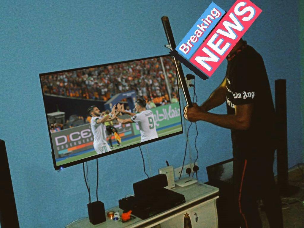 Young Nigerian Destroys His Television After Nigeria Lost To Algeria (Photos)