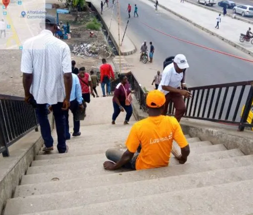 20 physically challenged employed by LAWMA as sweepers of pedestrian bridges in Lagos 3