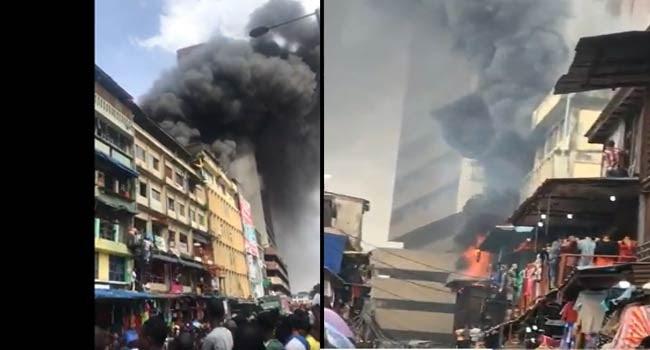 Thugs Loot Shops Affected By Balogun Market Fire (Photos)