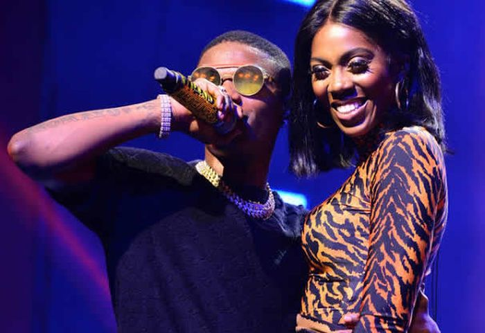 Tiwa Savage grabs Wizkid from behind during stage performance (video)