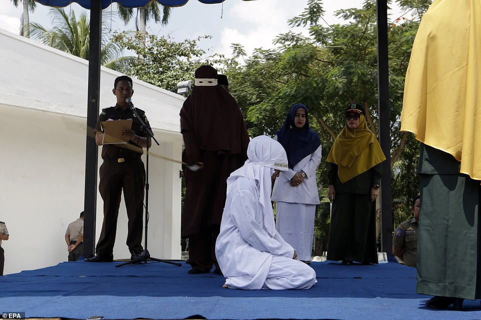 Indonesian Woman Publicly Flogged For Having S*x Outside Marriage (Photos)
