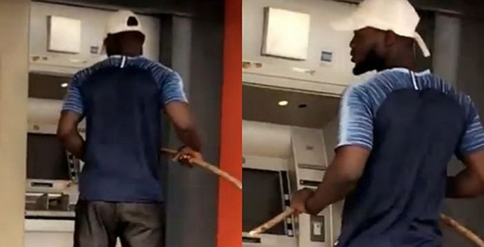 LOL! Watch Trending Video Of A Man Operating ATM With Stick Because Of Coronavirus 3