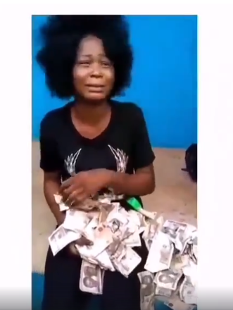 Lady Caught While Trying To Deposit N200k Worth Of Fake Currency At A POS Facility In Benin (Video)