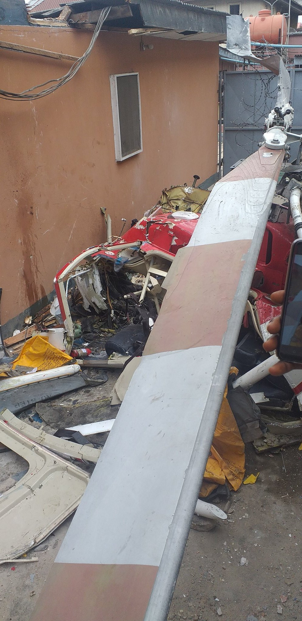 Two People Feared Dead As Helicopter Crashes Into Building In Lagos (Photos)