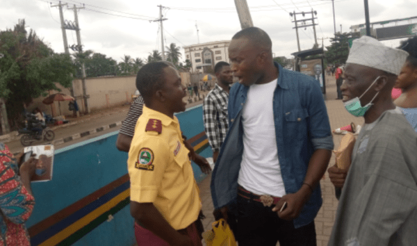 Two LASTMA Officers Seen Fighting Passenger Over N100 (Photos)