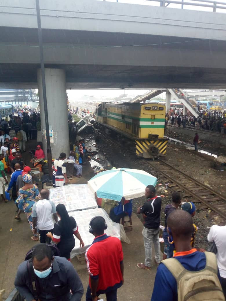 Commercial Bus Collides With Moving Train In Lagos (Photos)