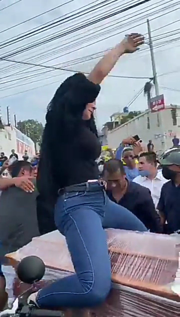 Woman Seen Twerking On Top Of A Coffin At A Funeral (Video)