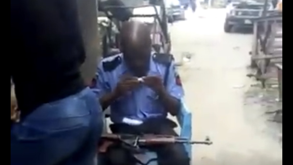 Policeman Seen Rolling Weed In Public (Video)